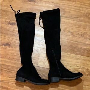 black thigh high boots/ over the knees